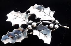 Festive pewter brooch in the design of a sprig of holly. Christmas Jewelry, Pewter, Brooch, Jewellery, Tin, Jewels, Christmas Ornaments, Schmuck, Jewelry Shop