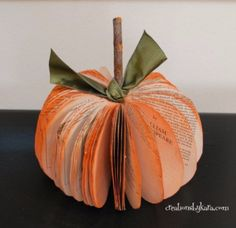 DIY Projects Made With Old Books - Book Page Pumpkin - Make DIY Gifts, Crafts and Home Decor With Old Book Pages and Hardcover and Paperbacks - Easy Shelving, Decorations, Wall Art and Centerpices with BOOKS http://diyjoy.com/diy-projects-old-books