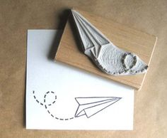 hand-carved paper airplane stamp by Jam Jam Sweet at etsy