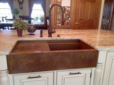 "Stone counter white with linear reddish lines shows off this 36"" Signature Series Rachiele copper apron front farmhouse sink with copper grid. Faucet set is Waterstone Traditional with pull down faucet."