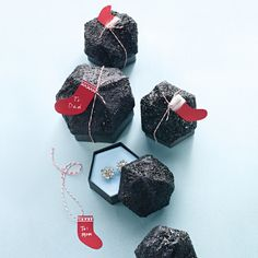 We all know what good-for-nothings get in their stockings: coal. But something is different this year. These sparkling nuggets are no ordinary lumps but gift boxes embellished with paint, paper, and lots of glitter. The faux-coal pieces are just the right size to package earrings, a rolled-up tie, and other small gifts. Looks like landing on the Naughty List isn't so terrible after all.