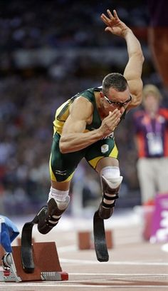 South Africa's Oscar Pistorius starts out of the blocks during his semifinal heats in the men's 400-meter