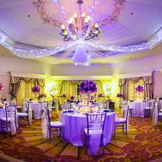 Elegant shades of purple combine to create a beautiful wedding reception
