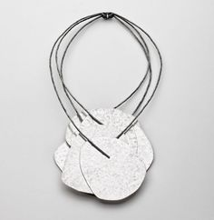 Iris Bodemer....Connie Fox: In relationship to the neckpiece the pendant is large scale.