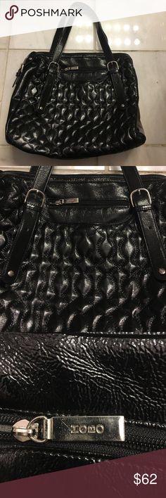 HOBO internat'l patent leather purse. Beautiful black quilted patent leather purse. Like new!! Outside magnetic closure pocket & smaller zipper pocket. Clean interior w/3 medium open pockets, 2 glass case size pockets & 2 pen/file holder pockets. Adjustable silver buckle straps & silver accents. HOBO International Bags Shoulder Bags