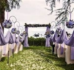 Lavender Wedding Aisle - Weddings on a budget with cheap wedding ideas, cheap wedding dresses and cheap bridesmaids dresses Wedding On A Budget, Wedding Ceremony Ideas, Wedding Planning, Wedding Church, Ceremony Arch, Wedding Receptions, Purple Wedding Decorations, Peacock Wedding, Ceremony Decorations