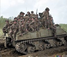 """OPERATION COLIN, BATTLE OF MAAS. Infantry of the 153rd Brigade, 51st Highland Division are carried into battle aboard a Sherman tank (T-233073) near Udenhout in the Netherlands. 29th of October 1944. **(additional info - this is the M4.Sherman Mk.I """"India"""" of B Sqn. 1Tp - 1st Northamptonshire Yeomanry, 33rd Armoured Brigade)**"""