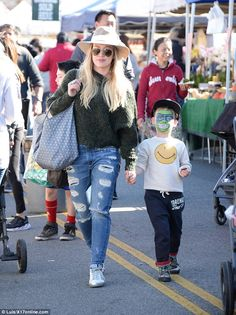 Sunday funday:Hilary Duff, 29, and her son Luca, four, were snapped at the Farmers' Marke...
