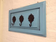 Repurposed Cabinet Door / Wall Hooks / Home Decor / Shabby Chic / Vintage / Cottage Chic / Turquoise / Mud Room / Entry way. $38.00, via Etsy.