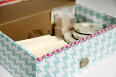 IHeart Organizing: DJ Jazzy Jen and the Fresh Shoe Box - how to cover shoe boxes (or other small cardboard boxes) with pretty wrapping paper to make great-looking functional boxes to put on bookshelves, etc