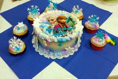Frozen cake with matching snowflake cupcakes