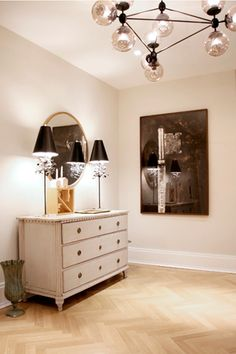 Chandeliers can get heavy and serious fast. But air-blown, glass fixtures add sophistication to a room without getting too stiff.