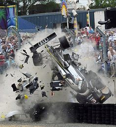 Allan McNish, Scot, Audi R18, #3, collided with Anthony Beltoise, French, slower Ferrari 458 Italia, #58 LeMans 24 hour race, 2011. -- Alan & photographers were lucky to escape death when his car careered across a gravel trap & smashed into the barrier.