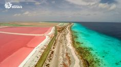 The amazing colors of Bonaire. This is the road south towards the White slave huts with on the left the Cargill salt pans and on the right the emerald blue ocean.