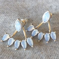 SaleOpal Jacket Earrings NWT. You could wear these just as studs or as jacket earrings. Silver plated brass and Opal crystals. So pretty! Only 2 pair available. I also have one Rose pair available. Price is firm. Sunahara Jewelry Jewelry Earrings