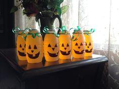 Juice barrels with pumpkin faces! Kids Halloween party drinks