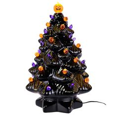 "Find the 14"" Black Ceramic Halloween Tree with Bulbs at Michaels"