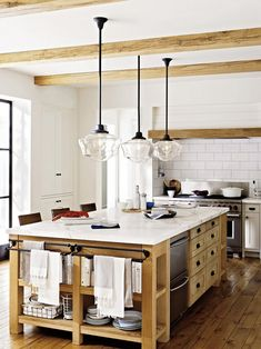 Wood and marble kitchen island via Rejuvenation on Houzz.
