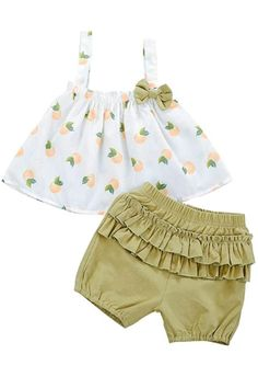A beautiful baby set, made of a soft and fresh fabric. Ideal for dressing girls in spring and summer. Feature: Sleeveless, strap ruffle top vest dress t-shirt with bowtie design and pleated shorts outfit set. Fruit print on hole top when your princess wear that more adorable.  #summerbabygirloutfits #summerbabygirlclothes #summerbabygirlclothesoutfits #summerbabygirlclothesinfants #babiesshirts Baby Girl Dress Design, Baby Girl Dress Patterns, Baby Clothes Patterns, Baby Dress, Ruffle Dress, Ruffle Top, Girls Summer Outfits, Dresses Kids Girl, Kids Outfits