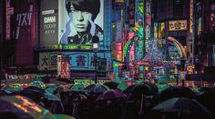 Una nottata piovosa: insegne luminose, grattacieli, ombrelli che riflettono le luci di Tokio di notte. Le meravigliose fotografie di un viaggio di Giappone.