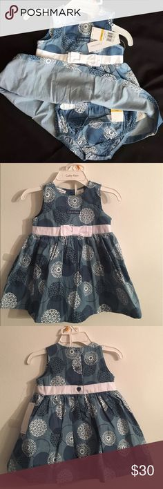 Calvin Klein baby girl dress 12M A sweet floral print sleeveless summer dress from Calvin Klein. LAST ONE • Button closure  • Cotton • Bow and ribbon at the gathered waist • Machine washable  ***SAME DAY FREE SHIPPING*** Calvin Klein Dresses Formal