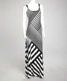 Diagonal stripes give this maxi dress oomph, while a free-flowing skirt caters graciously to curves.Size note: This item runs small. The vendor recommends ordering one size up.Measurements (size L): 65'' long from high point of shoulder to hem95% polyester / 5% spandex
