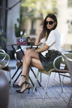 notonmyclothes:  the-streetstyle:  My Secret Barcelona With Reissviafashionvibe  Great look, so simple, heels, leather mini and white blouse, beat that, ha ha Oh and sunnies of course