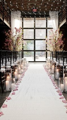 Aisle something like this but w/ prettier trees and floating candles also more flowers