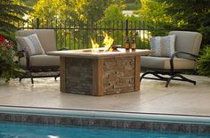 A fire pit table is great for entertaining because there's room for both drinks and plates. #outdoor #fireplaces #outdoor #entertaining mantelsdirect.com