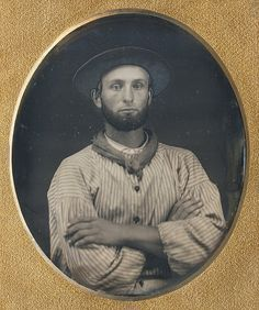 The broad-brimmed hat with a medium height crown (just visible in the surrounding darkness) resembles a style favored by California gold miners. 6th plate daguerreotype