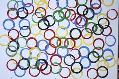 Olympic Ring art for kids: repurpose an old canvas or painting by stamping Olympic rings with cardboard tubes. A great kids' Olympic craft or art project.