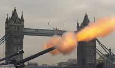 Boom: Soldiers from the Honourable Artillery Company fire blank rounds during the 62-gun Royal Salute at the Tower of London in front of Tower Bridge today