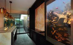Off-centered behind the bar, two large aquariums create a unique design aesthetic while also being an interesting talking point of the room. #aquariumarchitecture #fishtanks #aesthetics  #aquarium http://www.aquariumarchitecture.com/case-studies/custom-fish-tanks-feng-shui