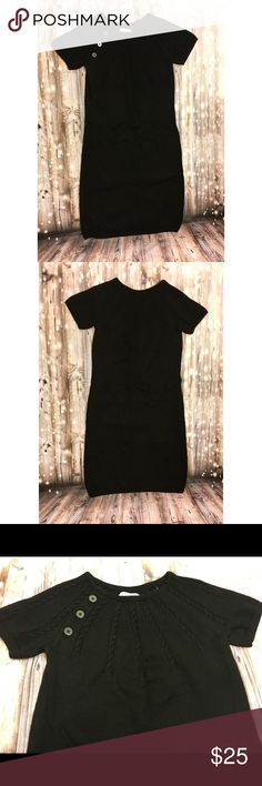 Calvin Klein black short sleeve sweater dress Black short sleeve sweater dress, 3 button design on right side, braiding design on top chest area, super cute soft and comfy, perfect for winter, great officewear or for a holiday party. Calvin Klein Dresses