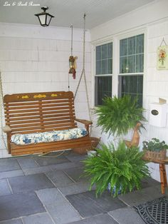 Our front porch swing. Backyard Swings, Porch Swings, Garden Projects, Diy Projects, Slate Flooring, Seasonal Flowers, Porch Decorating, Outdoor Furniture, Outdoor Decor