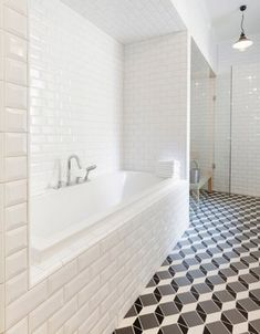 optical illusion geometric pattern floor in a bathroom by Linda Bergroth