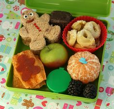 toddler lunch: ravioli, gingerbread man sandwhich, apples, clementine