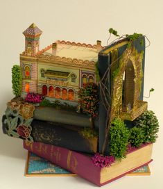 book sculpture ..... Seattle has an annual dollhouse show every spring!!!
