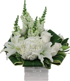 funeral flower arrangements | Solace White Sympathy Flowers | Canada Flowers