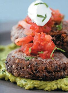 Black Bean Burger with Salsa and Guacamole! Perfect healthy options instead of fattening cheeseburgers for your next cook out. Recipe from mens fitness