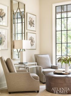 A quartet of club chairs cluster around a leather ottoman for a cozy seating area in the spacious kitchen.
