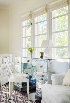 a mirrored desk in this master suite offers a perfect spot to sit and admire the view
