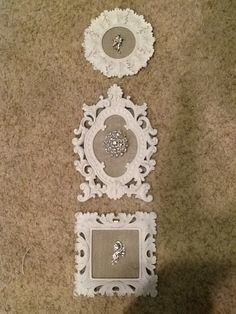 A little bling for the bathroom wall. Aunt Goldie's antique broaches mounted on burlap and framed.