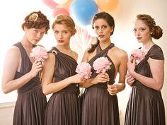 LOVE the bridesmaid dresses. Similar styles, different neckline :]