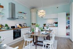 Kitchen in pastel colors (white and blue)