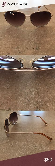 Michael Kors Aviator Sunglasses Authentic Michael Kors sunglasses gold frame and brown lenses. They are used with some wear on the frames. Comes with case and cleaning cloth. Michael Kors Accessories Sunglasses