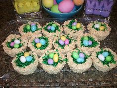 """My birds nests for Easter Sunday treats! Make rice krispie treats as box directs, spray muffin tins with Pam, form rice krisie treats into tins like nests, cool in fridge to hold shape. Take shredded coconut and color with green food dye for """"grass"""" & place a few pastel peanut m for ur """"eggs"""""""