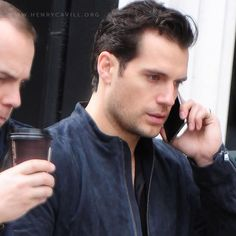 Henry Cavill was spotted drinking coffee and chatting his cell phone while walking down the street in London together with his brother, Simon Cavill on September 27, 2016. All the images http://henrycavill.org/en/media-gallery/images/candids/item/1512-henry-cavill-out-and-about-in-london-with-his-family