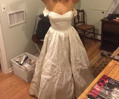 Thought my mom's first wedding dress looked better without the sleeves. Do you agree? But I LOVE the neckline!
