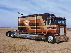 Custom Gold and Brown Cabover With A Pretty Long Sleeper